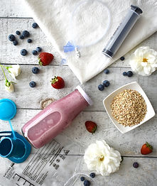 blended diet for tube feeding a pink blend of berries and oats.