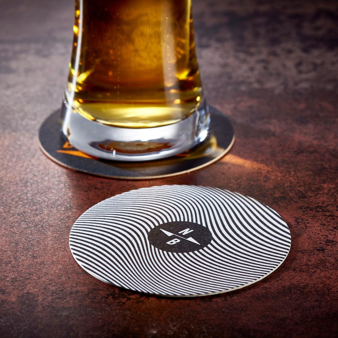 North Brewing Black & White Spiral Beer Mat