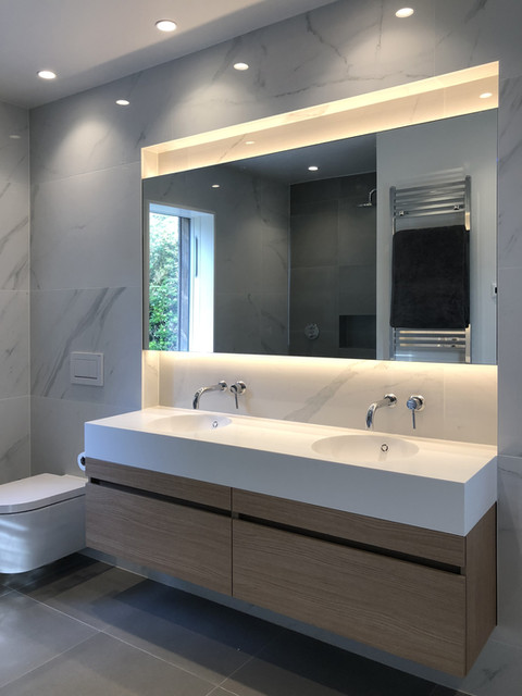 Haslemere modern bathroom with marble tiles, corian vanity & light slots
