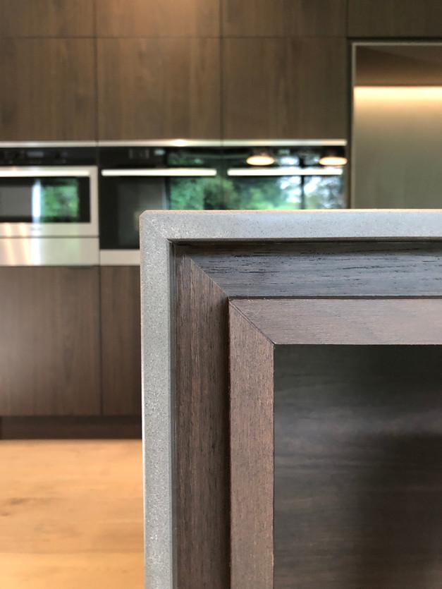 Walnut kitchen with stone worktop island shadow gap detail
