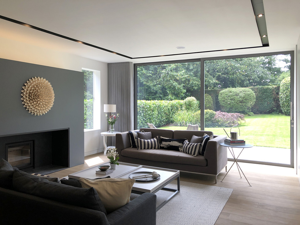 Modern living room with sliding doors to garden in Haslemere