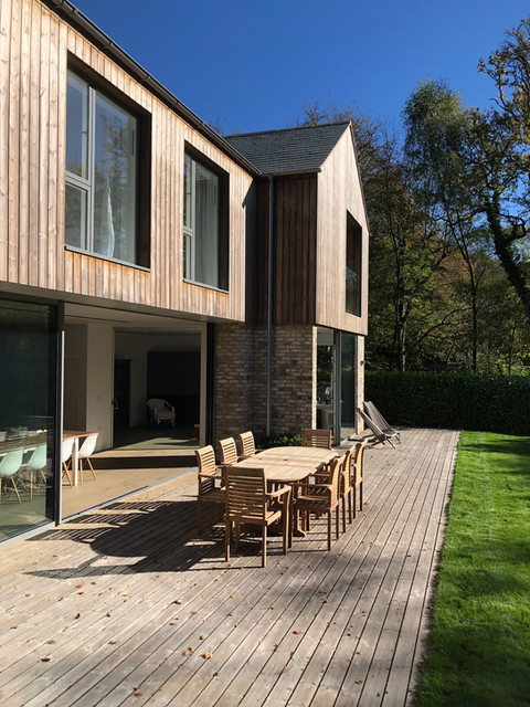 Haslemere modern house with timber cladding & decking