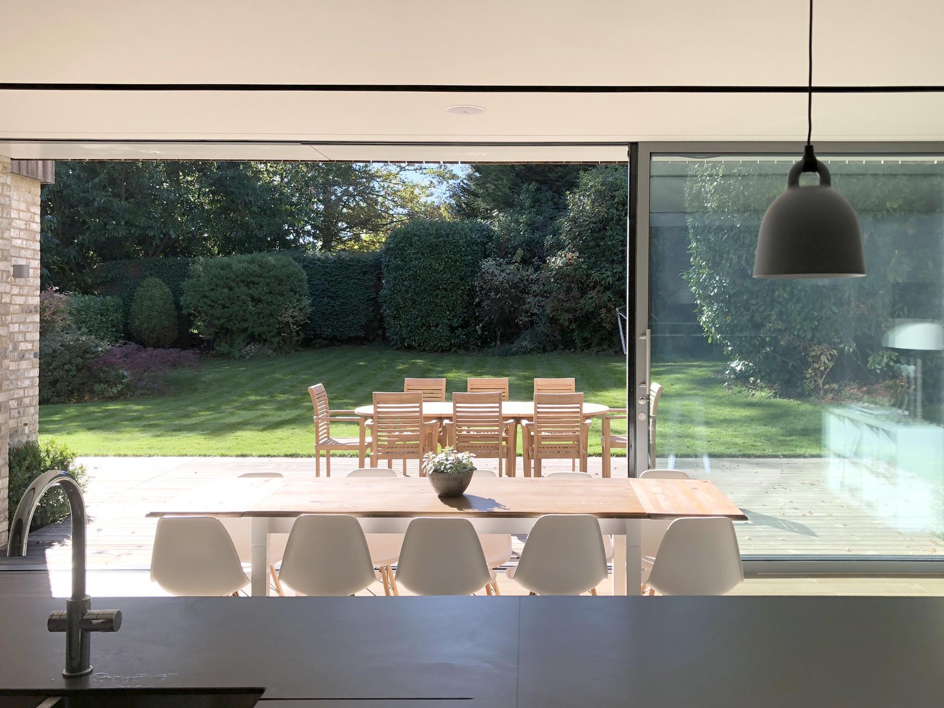 Sliding doors modern interior of home in Haslemere, Surrey