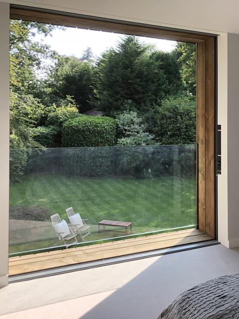 Modern house pocket sliding door in Surrey