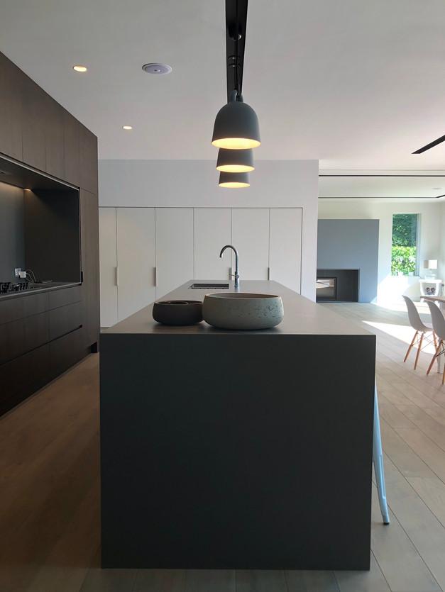 New house in Surrey, modern kitchen island with stone worktop & pendants