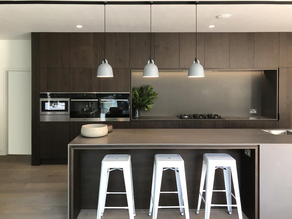 Dark walnut kitchen contemporary interior in Haslemere, Surrey