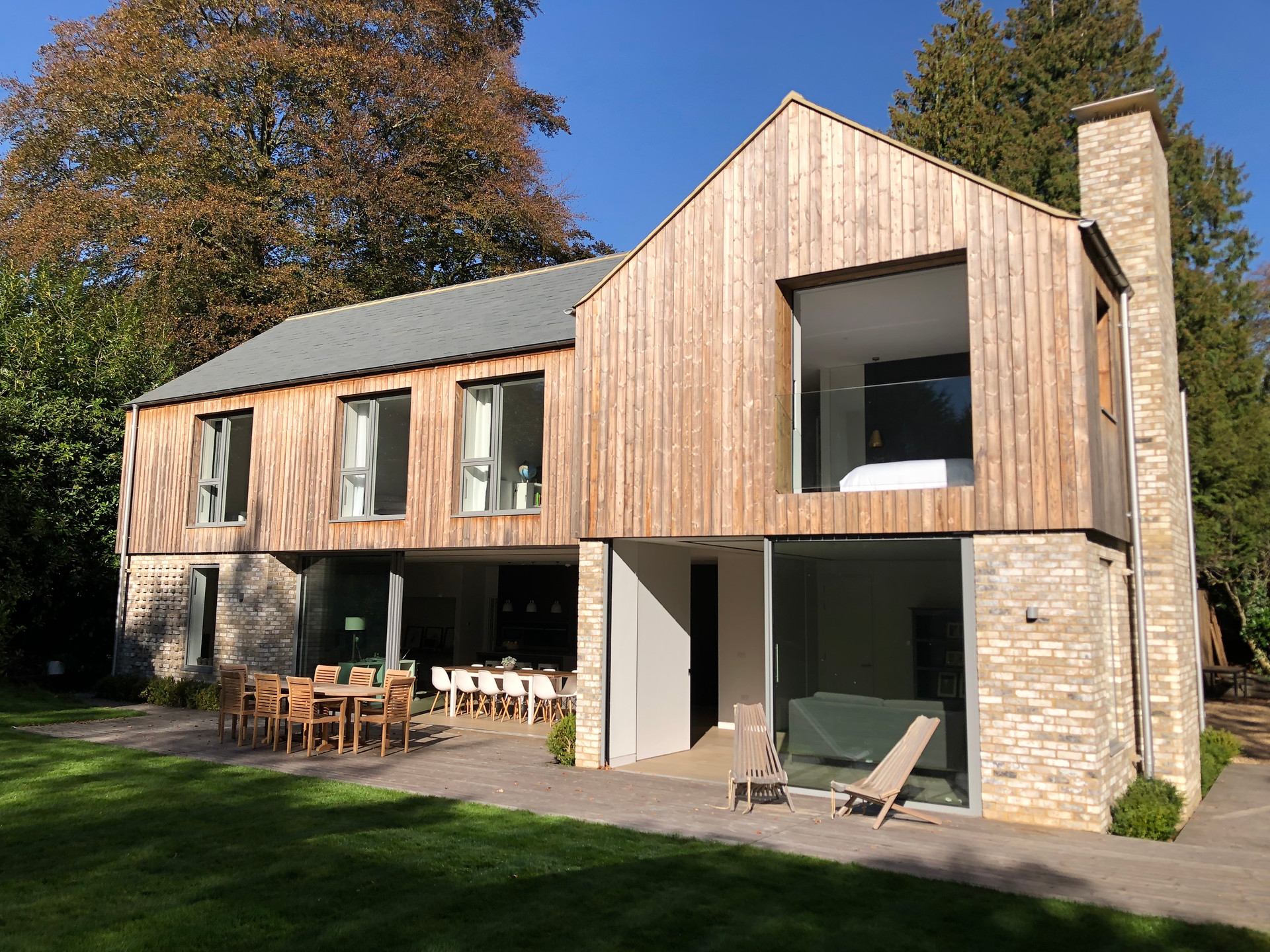 Modern house with vertical timber cladding in Haslemere, Surrey