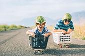 Young Boys Racing Wearing Watermelon Helmets