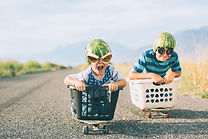 Young Boys Racing Wearing Watermelon Hel