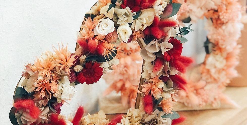 Corazón con flores preservadas