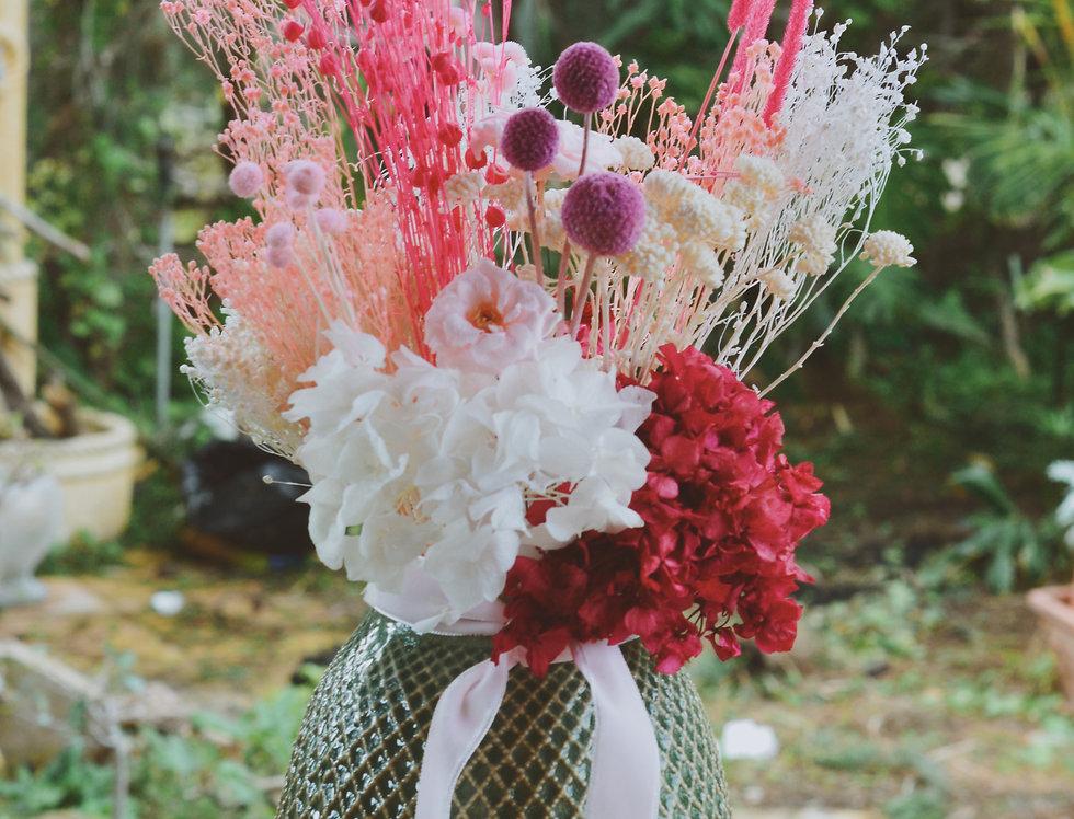 Jarrón con flor preservada