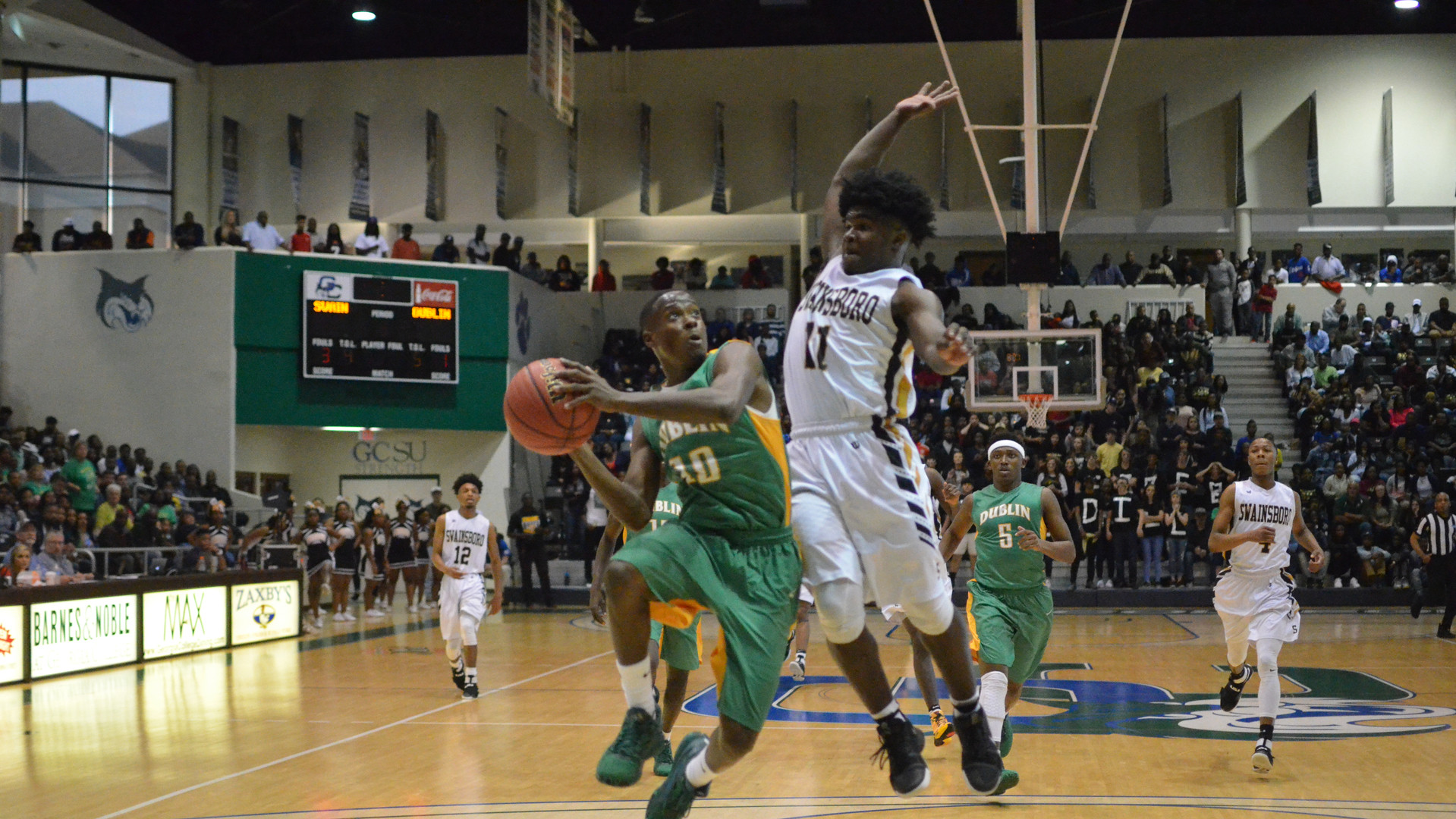 Swainsboro defender Jaylan McKinney leaps to block the shot of Dublin's Holden Baisden during a 2017 state semifinal game at Georgia College in Milledgeville. The Tigers' frustrating defense short-circuited Dublin's hot shooting in a heartbreaking defeat for the Irish after a second-consecutive deep playoff run.