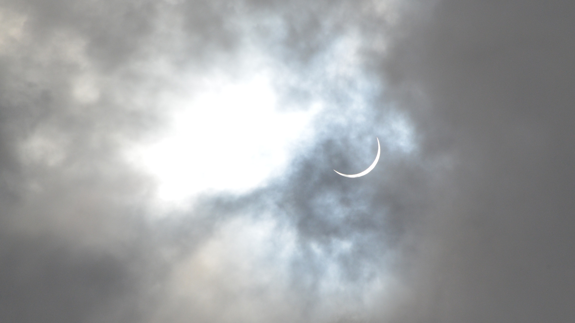 Light from a partial solar eclipse peeks through a veil of clouds that obscured it from view during rainshowers that overlapped with its phase of near-totality above Middle Georgia on August 21, 2017. Due to the inclement weather, the once-in-a-generation event was largely a disappointment for viewers across the region, who missed out on a chance to observe its climax around mid-afternoon. This small glimpse, as well as roughly an hour of clear skies unveiling the latter stages of the eclipse, provided some silver lining for those who got a chance to view it.