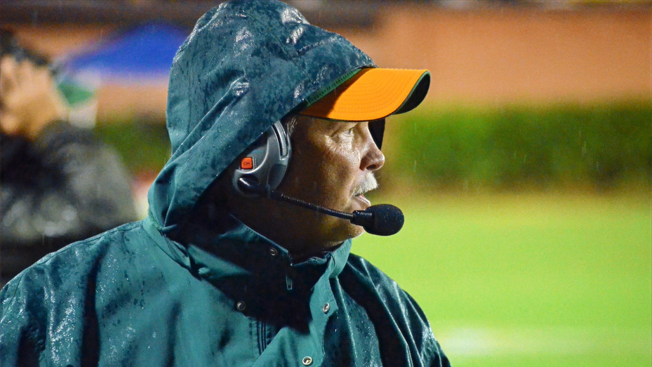 Dublin High School head football coach Roger Holmes paces the sideline of the rain-soaked Shamrock Bowl during his team's first-round win over Toombs County in the 2018 GHSA state playoffs.