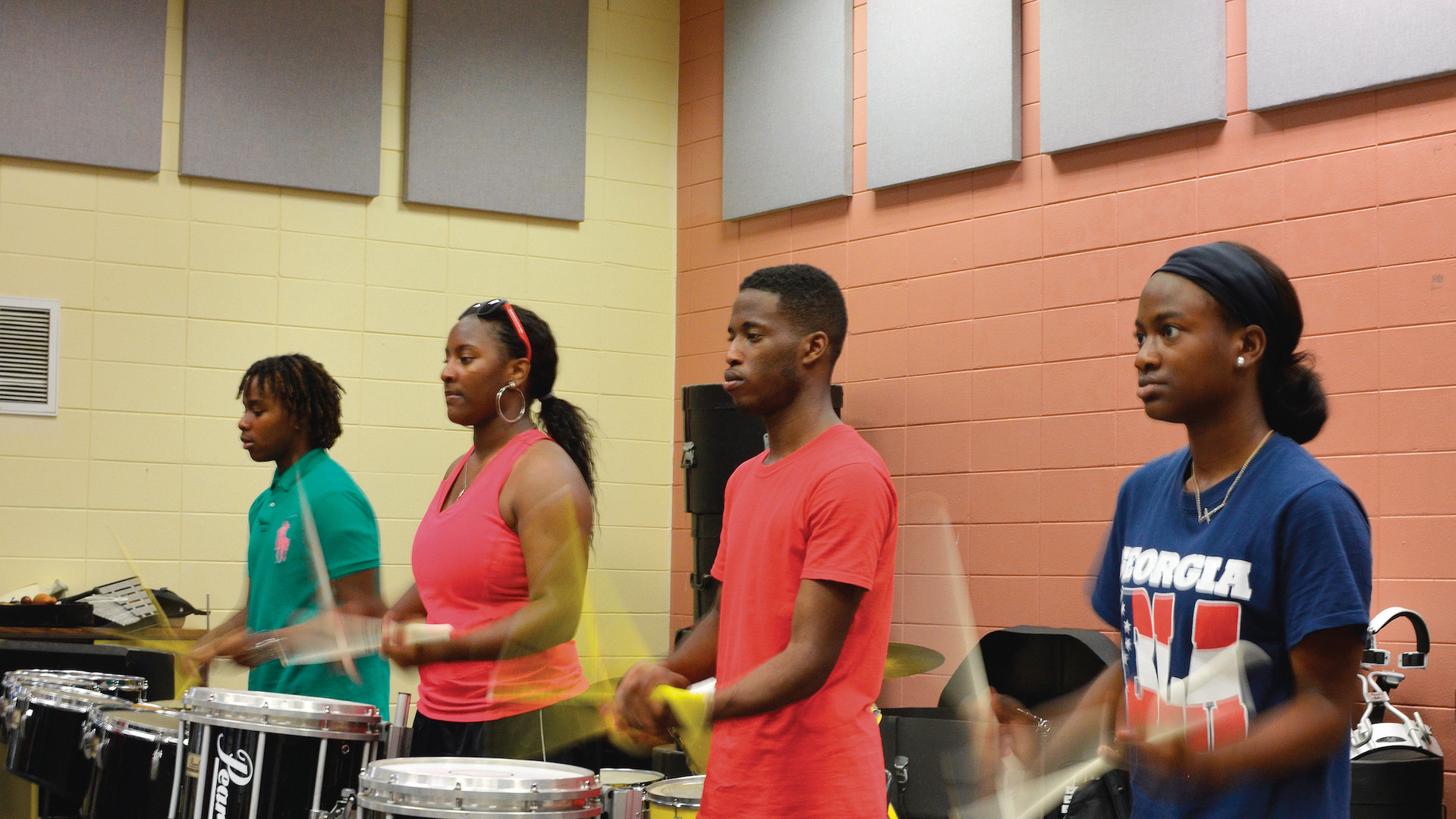 "Members of the East Laurens High School ""Band of Gold"" drumline rehearse during the school's 2015 band camp."