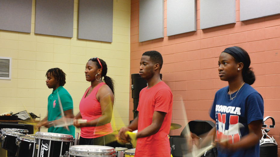 """Members of the East Laurens High School """"Band of Gold"""" drumline rehearse during the school's 2015 band camp."""