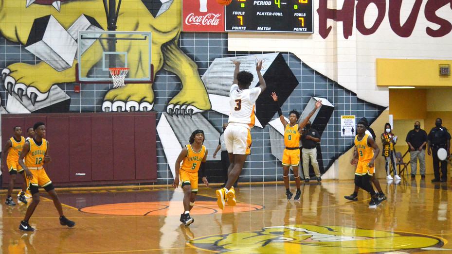 Hancock Central's Jamal Taylor lifts up the game-winning half-court shot at the buzzer of the 2021 Class A Public State Semifinals. The senior drained the impossible last-minute 3, to send the Bulldogs past Dublin and into the state title game for a second-straight year.
