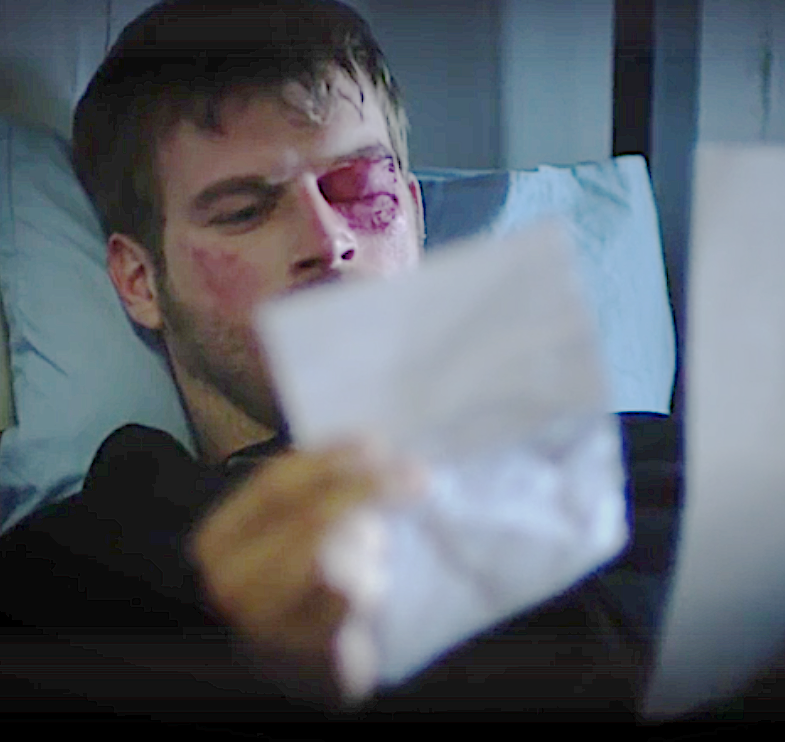 Kuzey in prison reading letter from Cemre