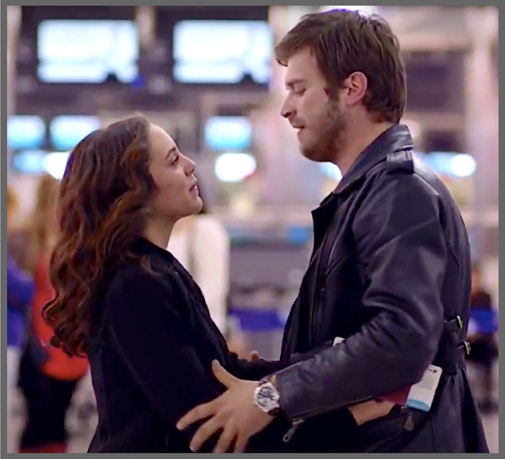 Kuzey an Cemre embrace in airport