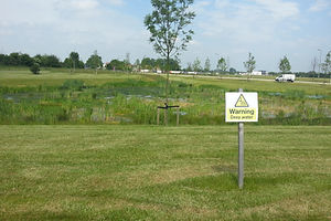 Bicester pond with warning sign.jpg