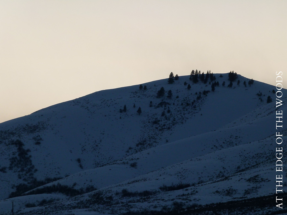 sunset behind the snowy hilltop
