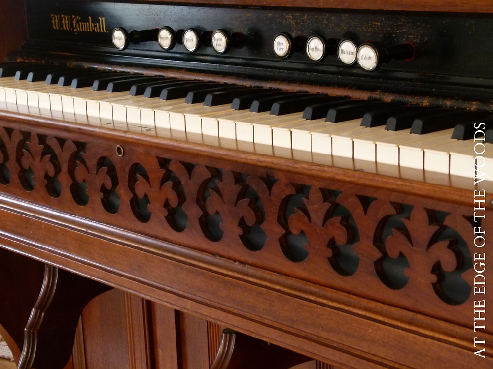 the decorative front piece on the pump organ