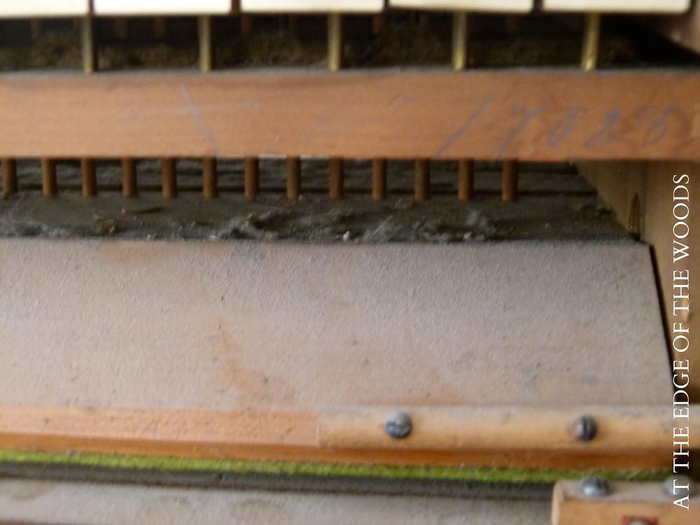 under the keys of the pump organ