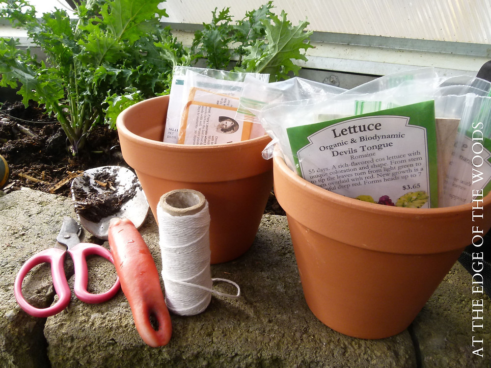 clay pots, seed packets, garden tools, and twine