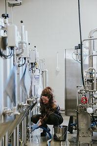 A woman brewing beer
