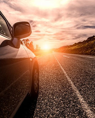 car-travelling-by-sunny-road_1088-51.jpg