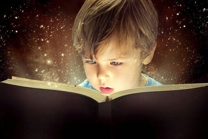Child opened a magic book.jpg