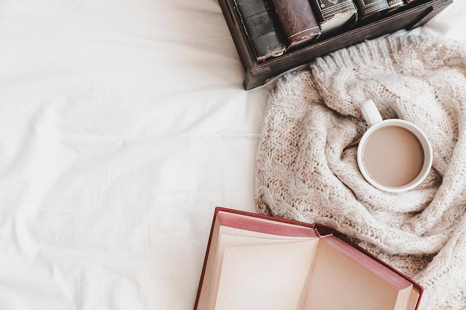 otebook-box-with-books-near-hot-drink-plaid.jpeg