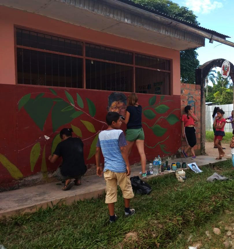 "painting the mural ""roots"" in peru"