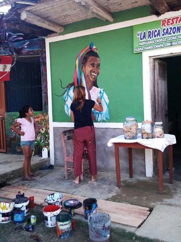 paintin the mural quechua lamista in Peru