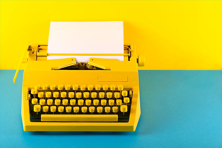 Yellow bright typewriter on a yellow and