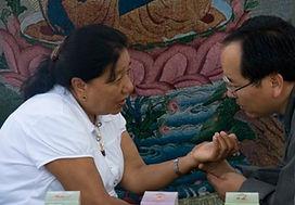 Tibetan Medicine Doctor (Amchi) Reading Pulse