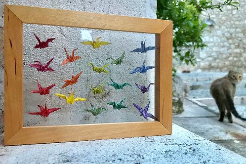 18 tiny birds behind glass