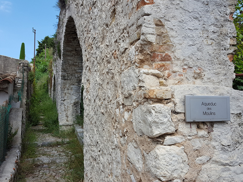A few feet away are remains of an aqueduct that delivered water to the mill.