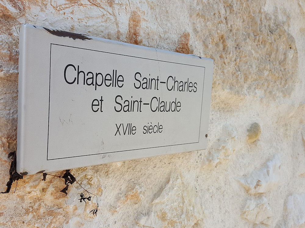 Up the way there is another chapel, this one shared by Saints Charles and Claude.