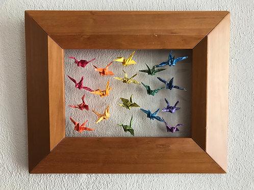 Eighteen tiny birds in a beveled oak frame