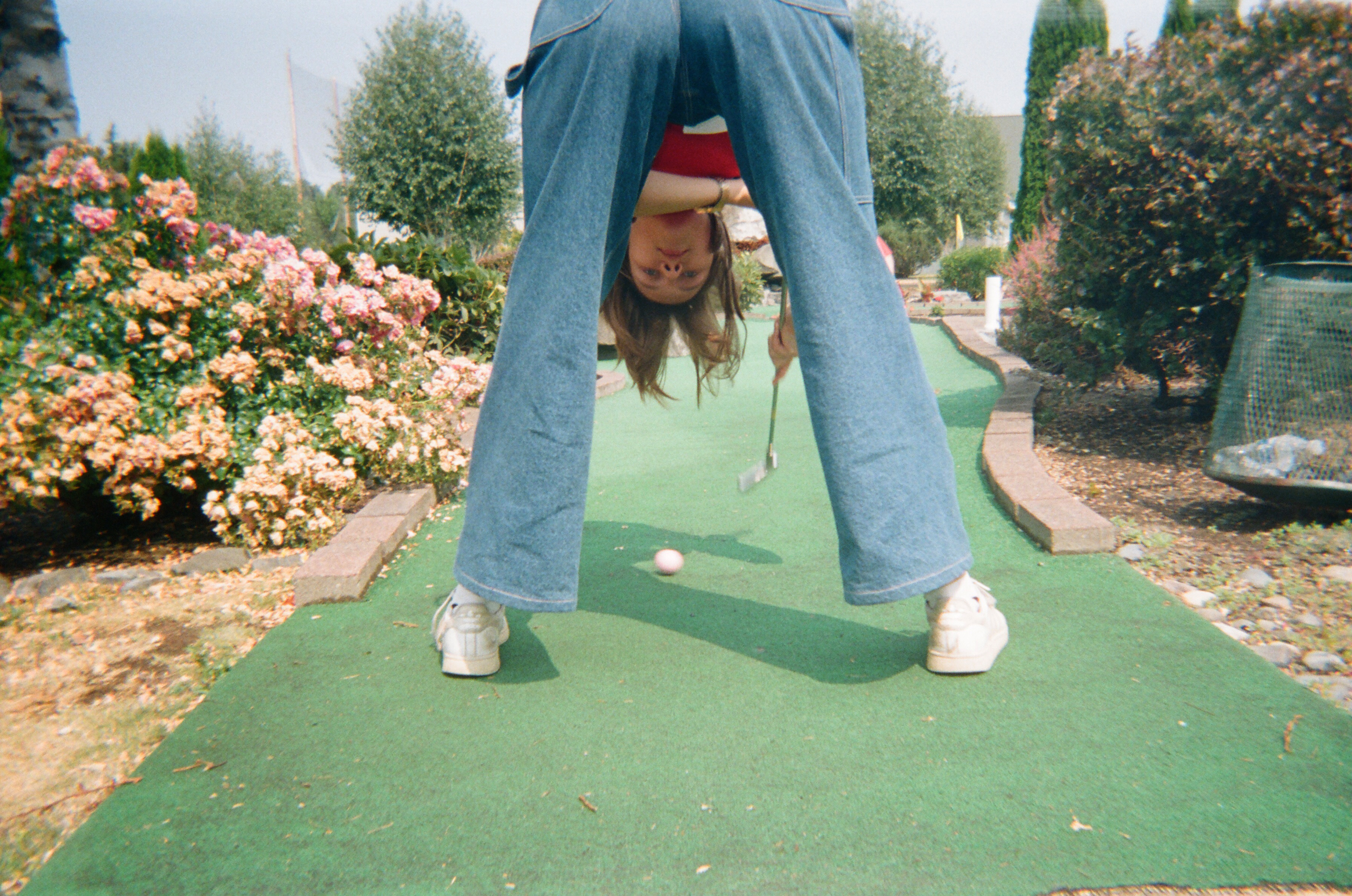 Sasha golfing upside down
