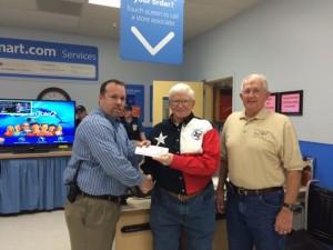 Tom McDonough Accepts WalMart Donation