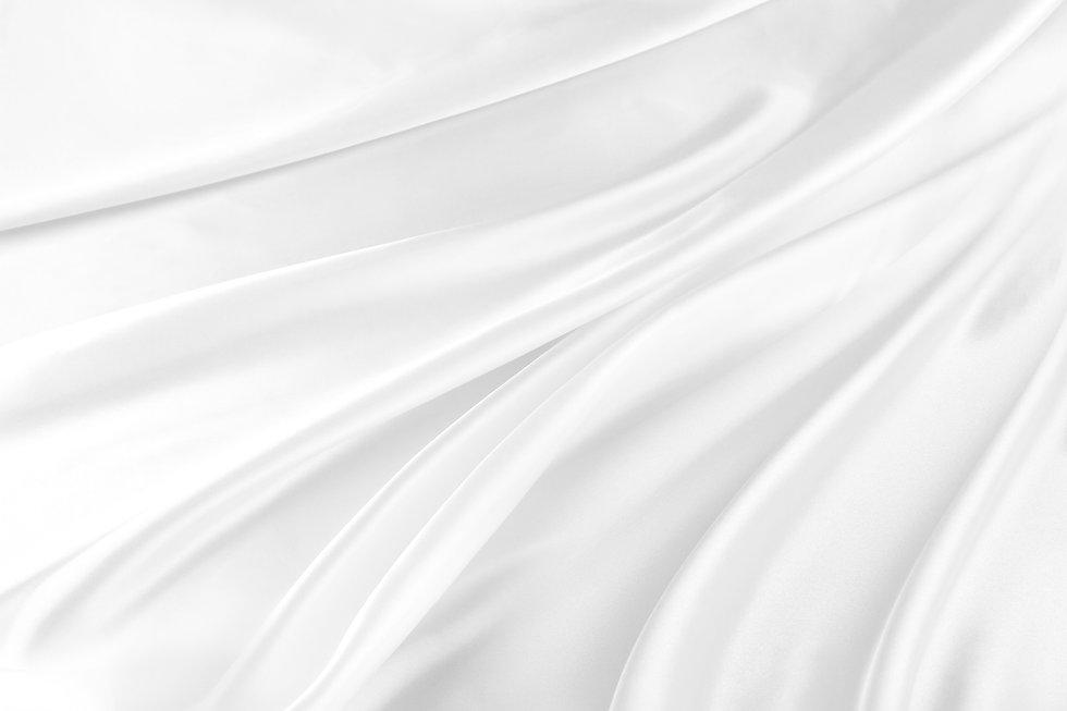 Closeup of rippled white silk fabric.jpg