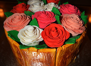 Wooden bucket of roses cake