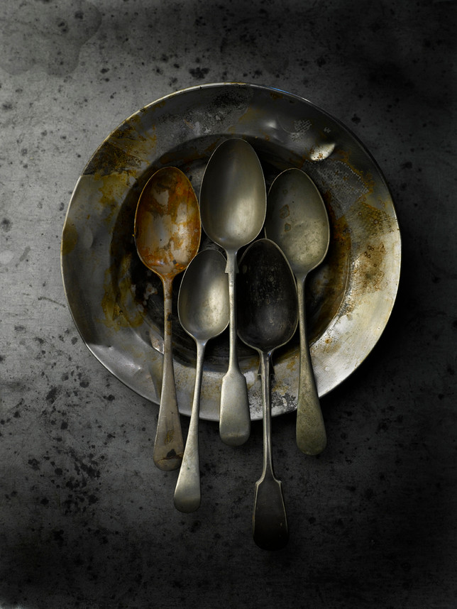 Spoons on tin plate