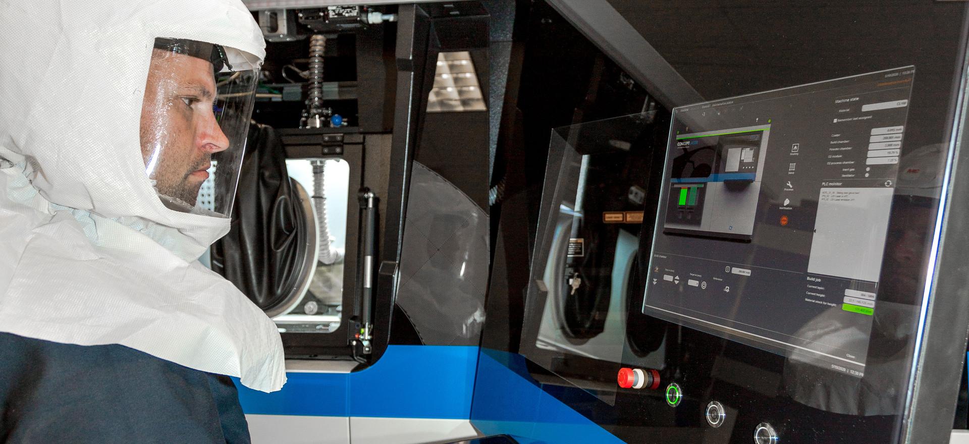 Operator on the GE Additive M2 Metal printer