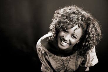 beautiful-black-woman-on-black-background-studio-shot-30301884.jpg