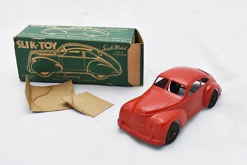 Slik-Toy Red Aluminum Passenger Sedan by Lansing.