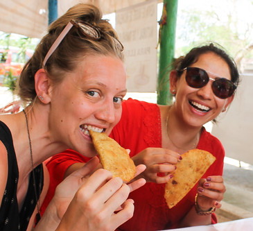 3 people eating empanadas at a local restaurant during a soul trip