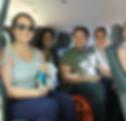 5 people in a van smiling